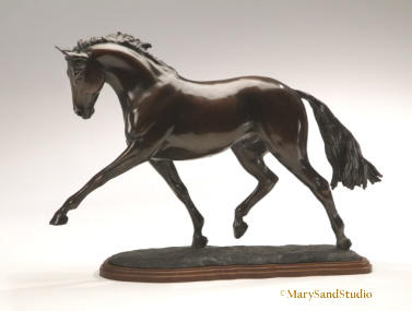 Bronze dressage horse sculpture of hanoverian horse performing the extended trot. Sculpture titled Breathtaking
