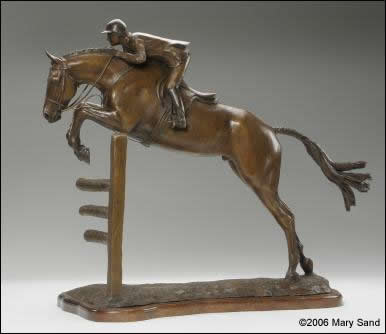 Horse sculpture of a young hunter jumper taking off over a jump.  Sculpture of jumper is titled Young Hunter and is a bronze limited edition of 15
